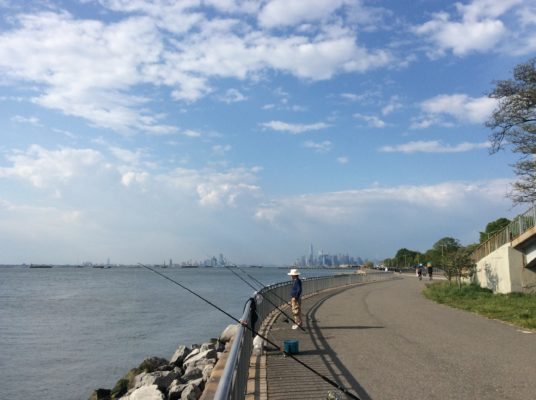 1 Fisherman, 3 rods, 2 cities. NJ and NYC from Bay Ridge, Brooklyn.