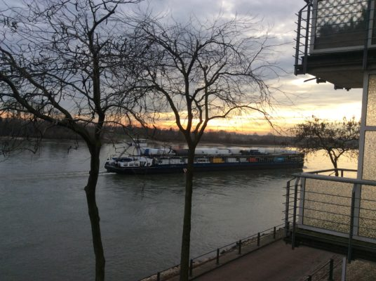 Cargo or cars floating on the Rhine.