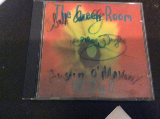 A signed copy of the Green Room UCC Live Music College CD found in Olli's apartment.